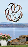 "Ancient Graffiti Kinetic Dual Flower Spinner, Copper, 87""H"